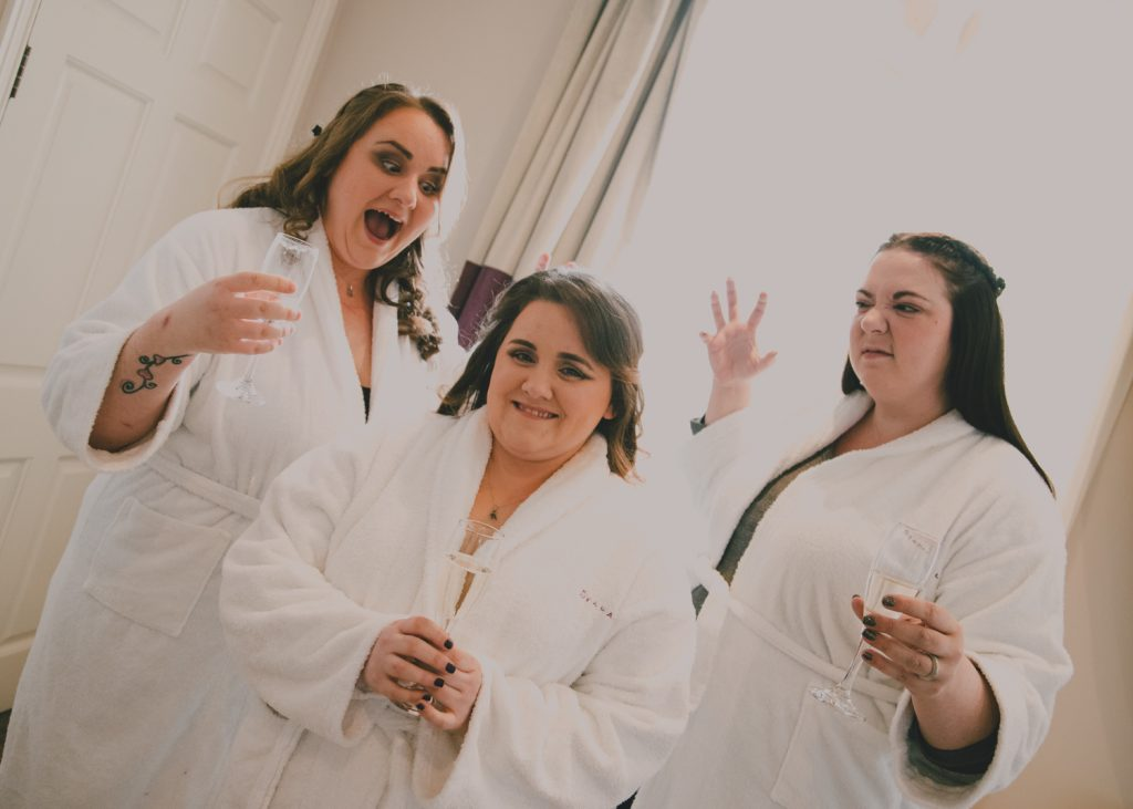 Bride and bridesmaids practicing their scary faces for halloween