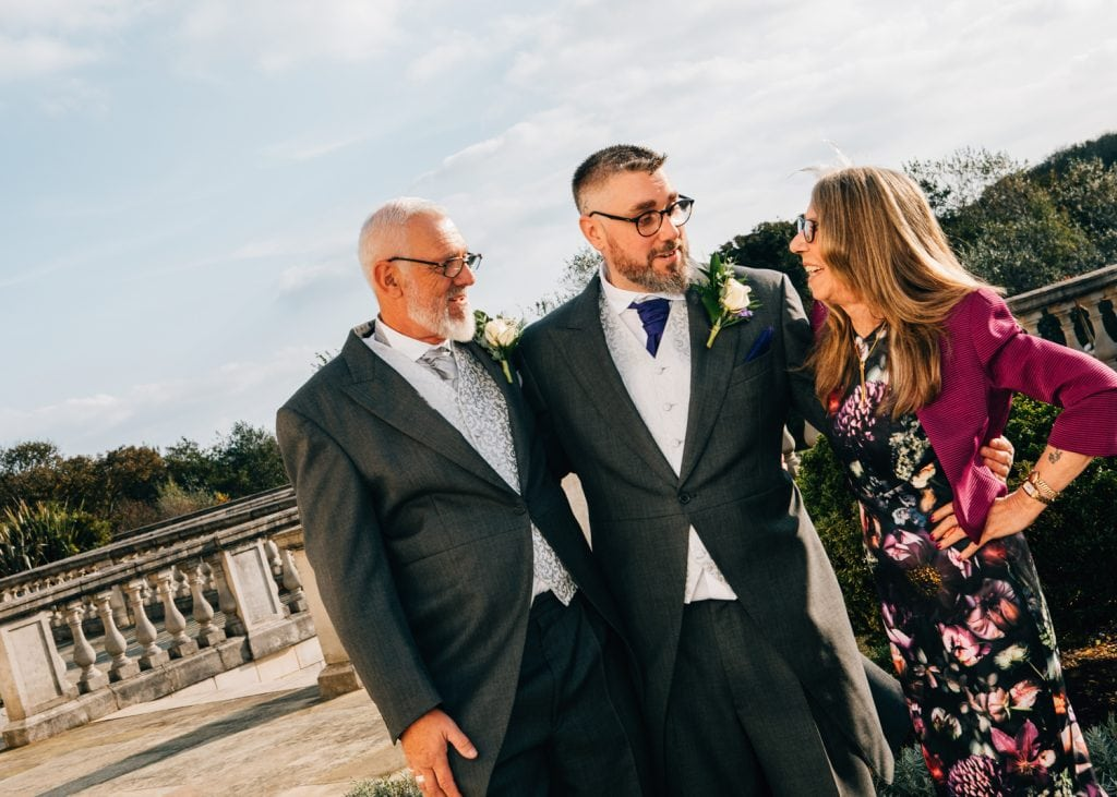 Groom and his parents at Seaham Hall Gardens