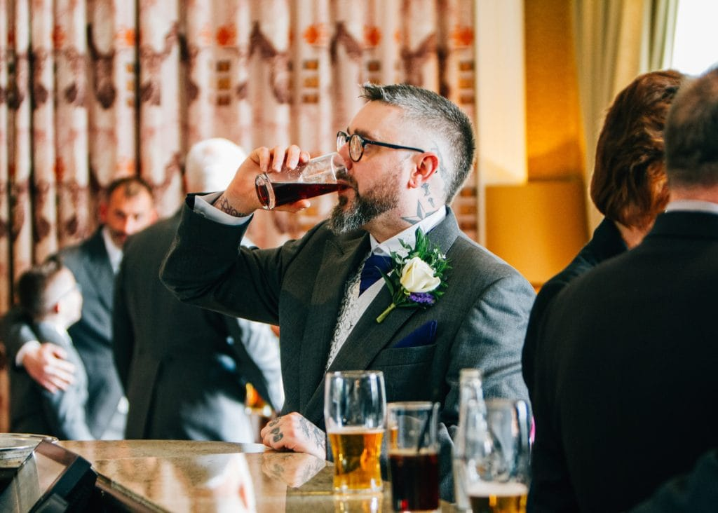 Groom downing a quick drink