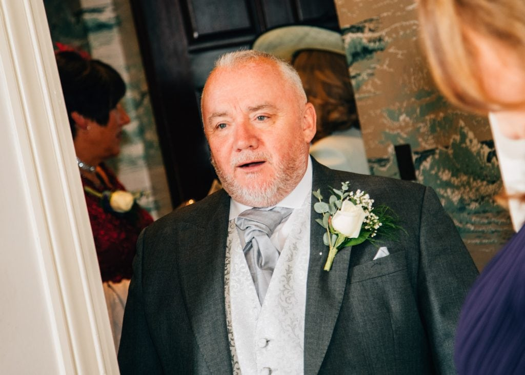 Father of the bride seeing his daughter in her wedding dress for the first time.