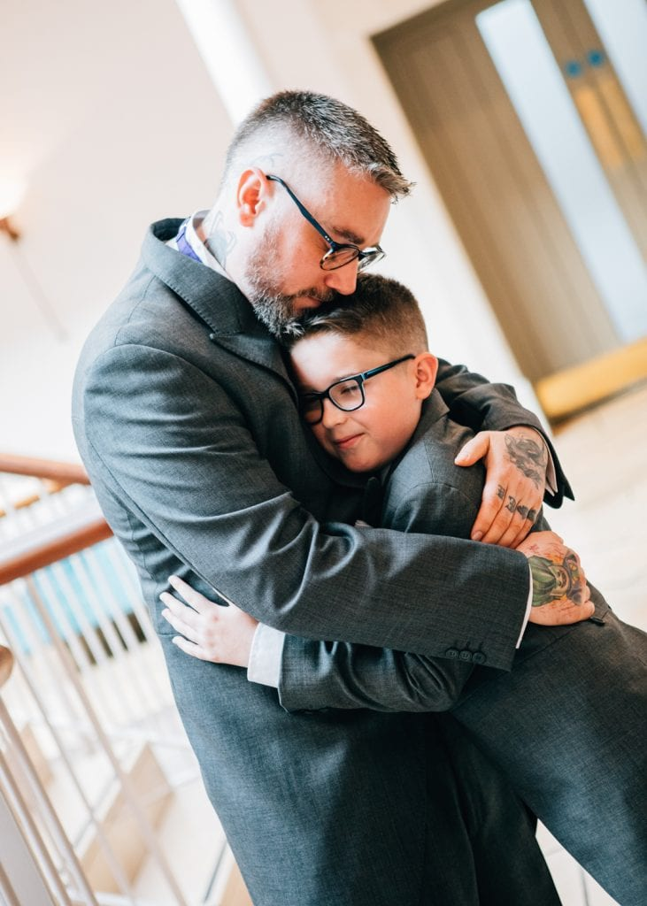 Groom hugging his son at Seaham Hall