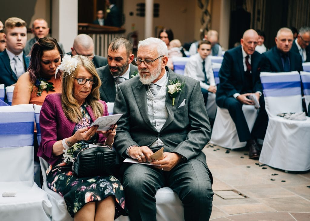 Wedding guests reading service book