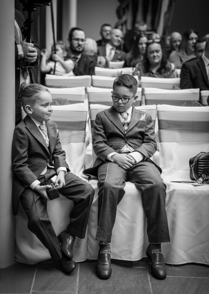 Page Boys chilling during the service