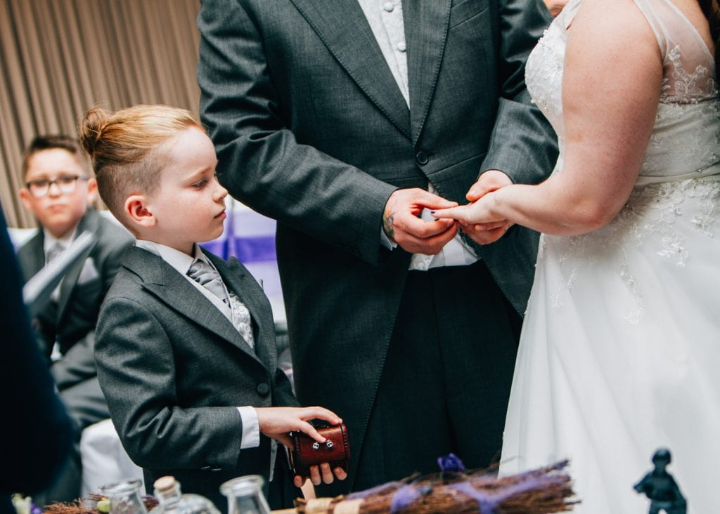 Page Boy presenting the wedding rings