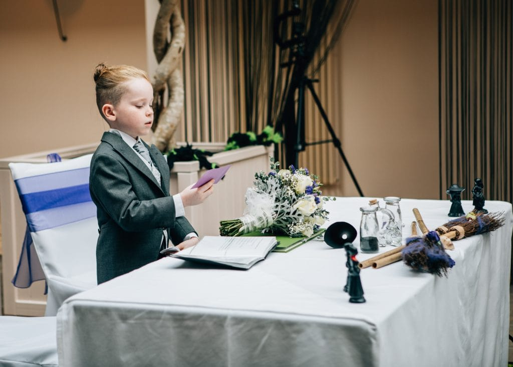 Grooms son making a reading