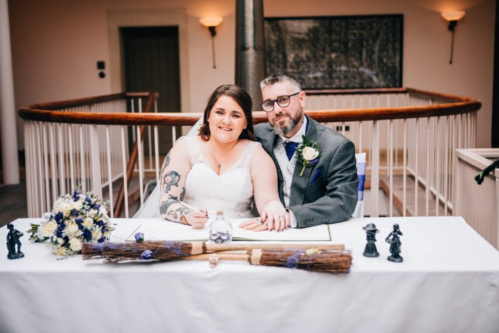 Bride & Groom signing the register at Seaham Hall