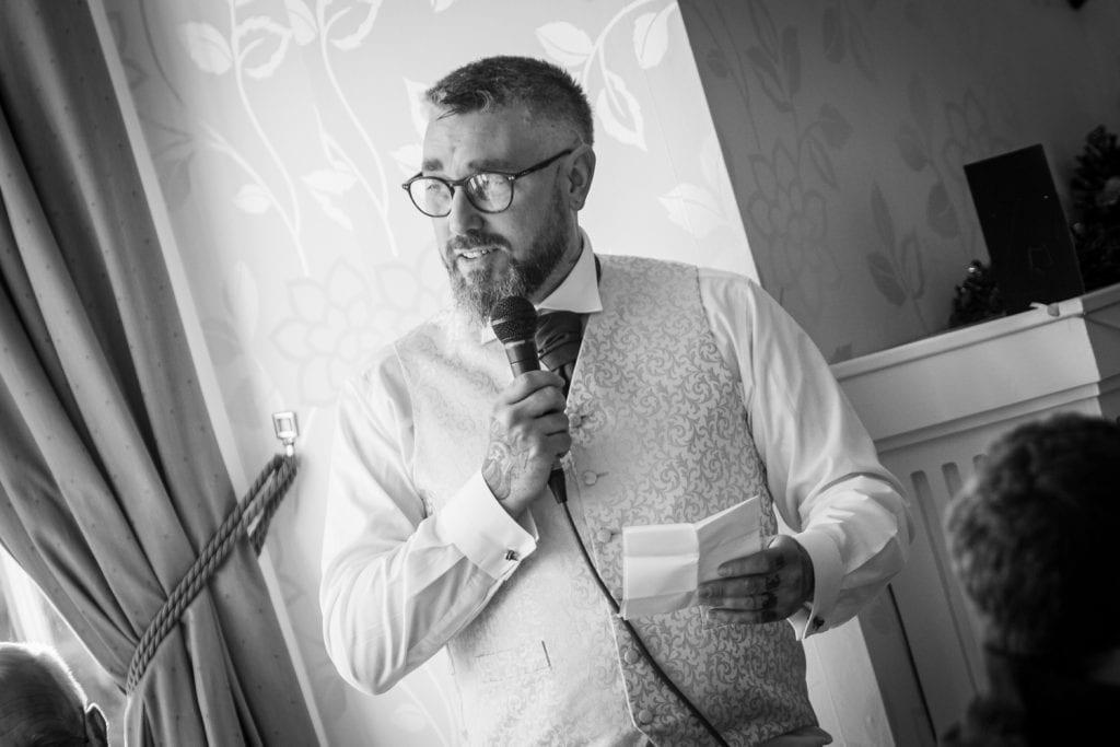 Groom reading his wedding speech