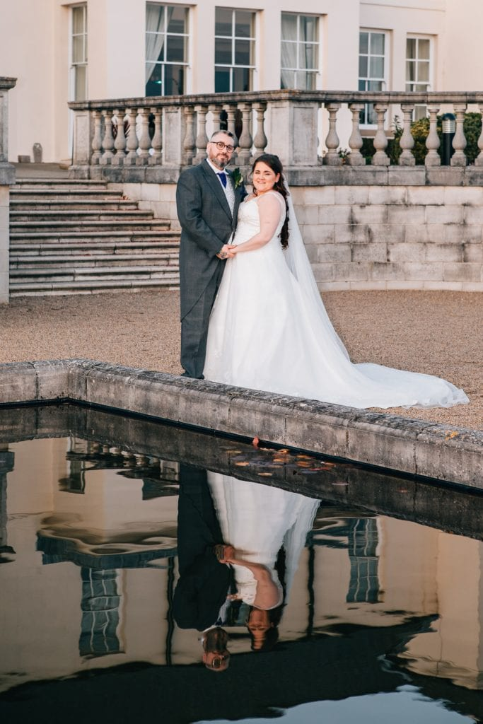 Bride & Groom reflected in Seaham Hall water feature