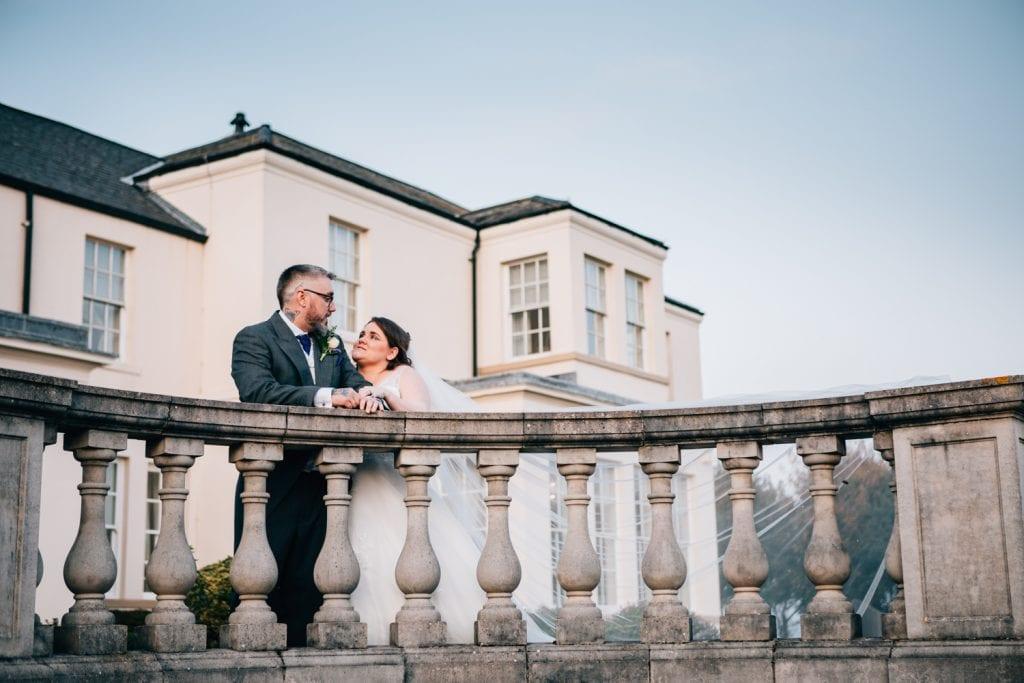 Bride & groom talking on the terrace of Seaham Hall