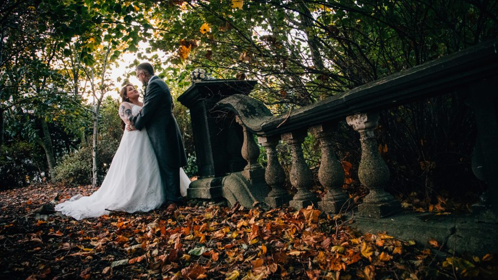 Ben & Emma hugging in the autumn leaves