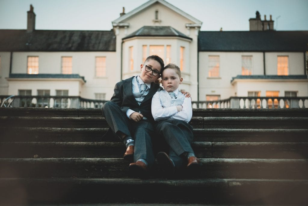 Pageboys on the steps of Seaham Hall