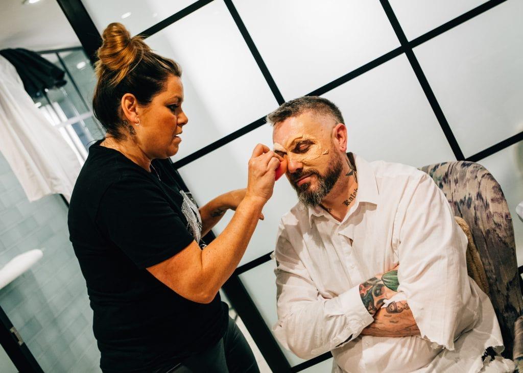 Groom having zombie makeup applied