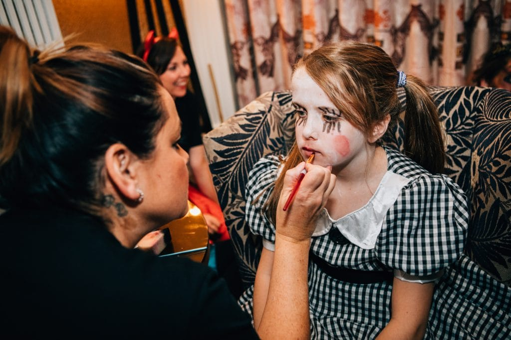 Young guest having her face painted