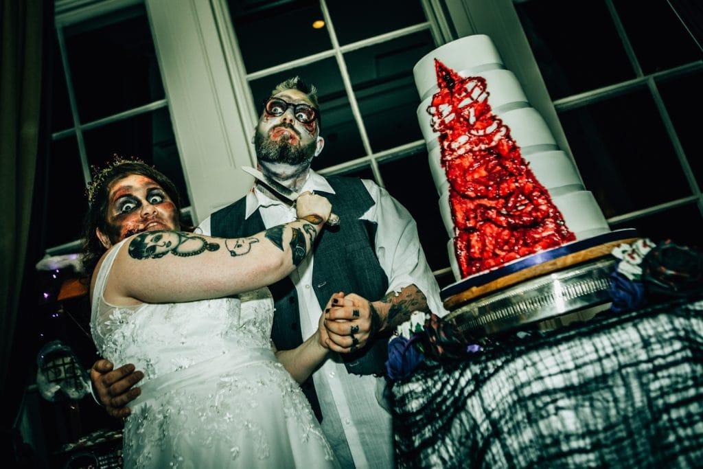 Bride cutting grooms throat instead of wedding cake.