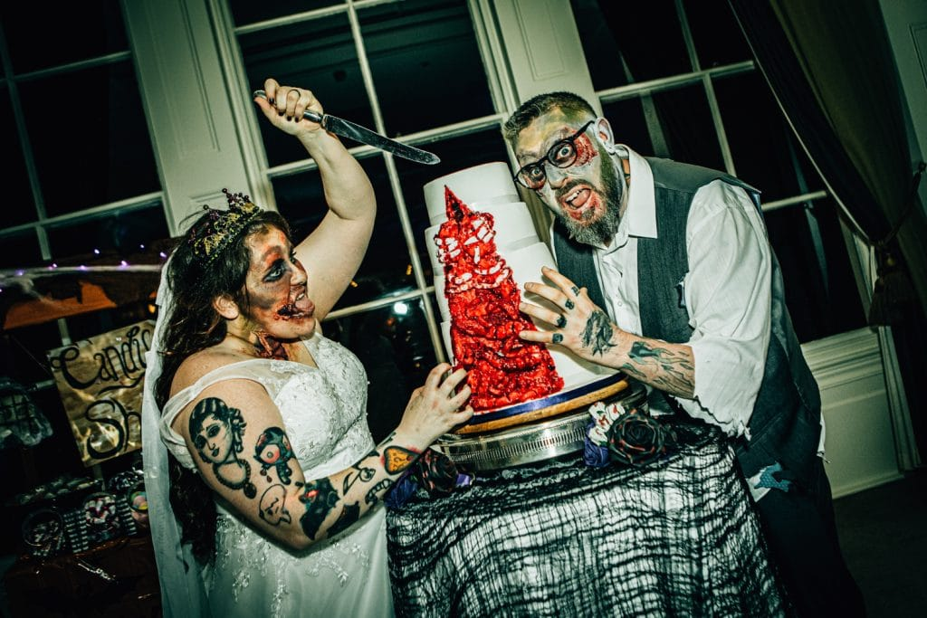 Zombie Bride & Groom Attacking wedding cake at seaham hall