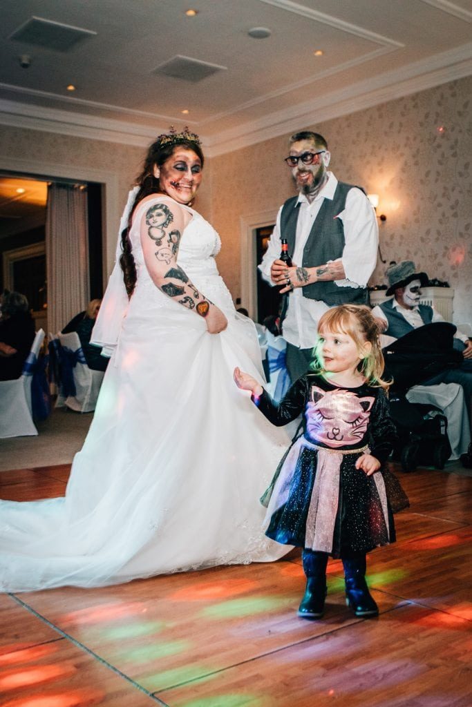 Emma & Ben dancing with a young guest at Seaham Hall
