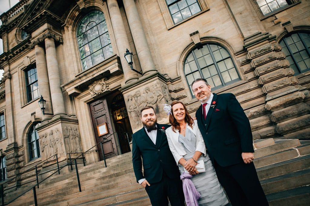 Groom & his parents in front of South Shields Town Hall