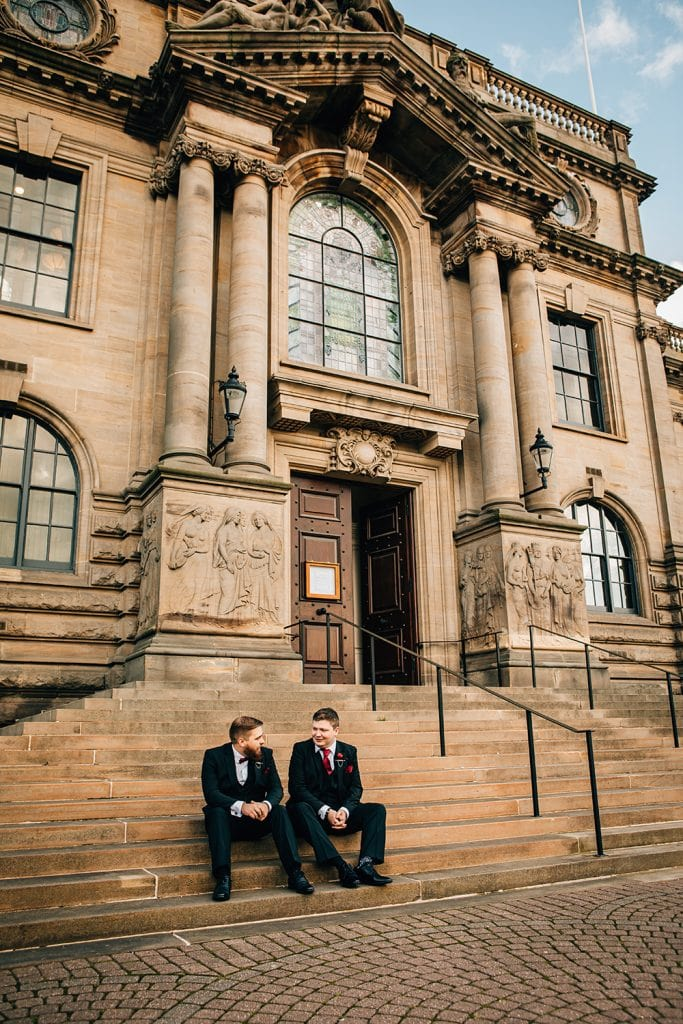 groom & his family sitting on the steps of South Shields Town Hall
