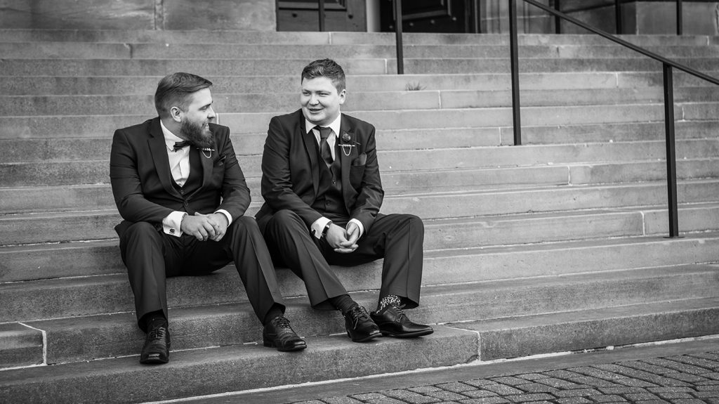 Groom & his brother laughing on the steps of South Shields Town Hall