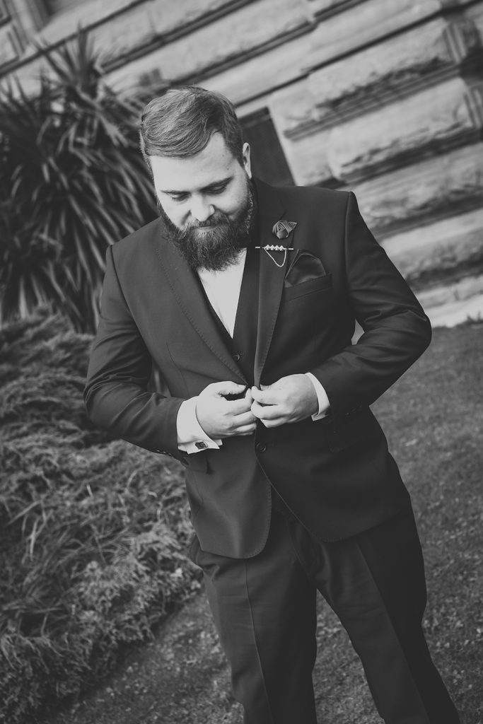 Groom checking his suit