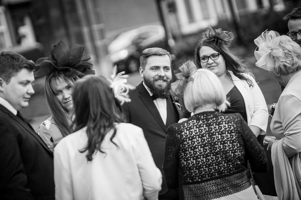 Groom greeting guests at South Shields Town Hall