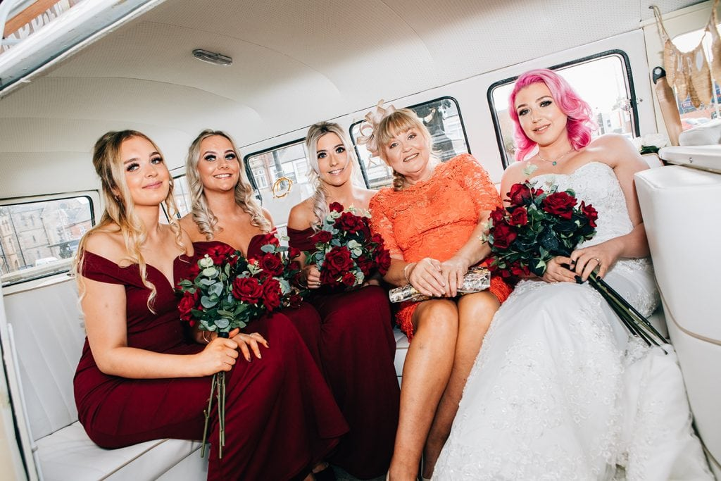 Bride & Bridesmaids sitting in their VW Camper Van