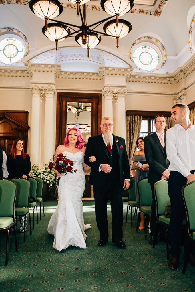 Bride walking down the aisle at South Shields Town Hall