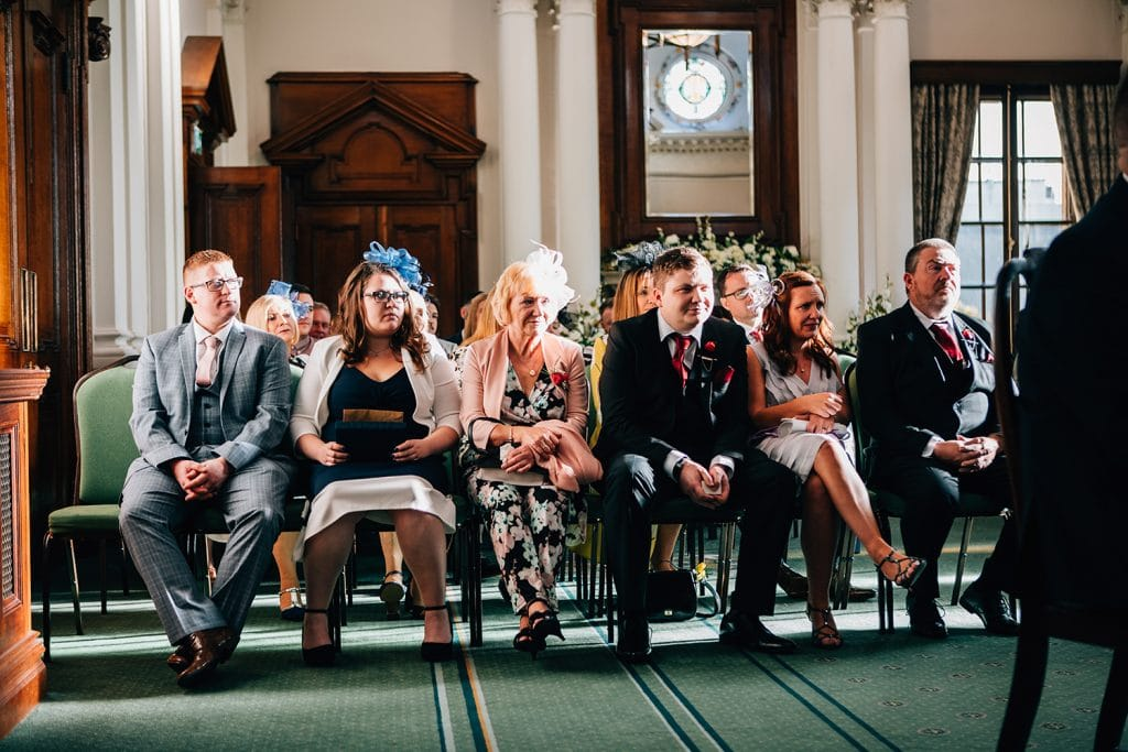 grooms family watching wedding service