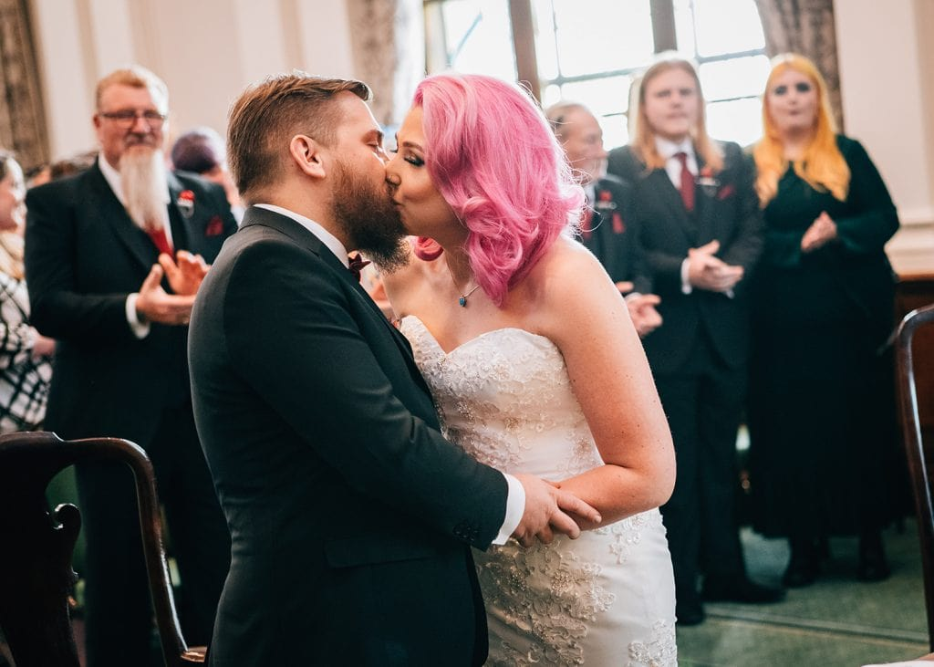 Bride & Groom kissing after their wedding service