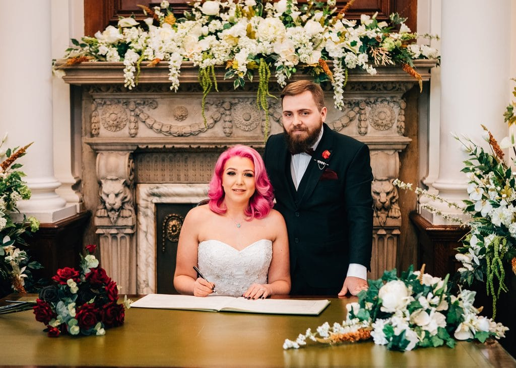 The Bride & Groom signing the regisiter at South Shields Town Hall