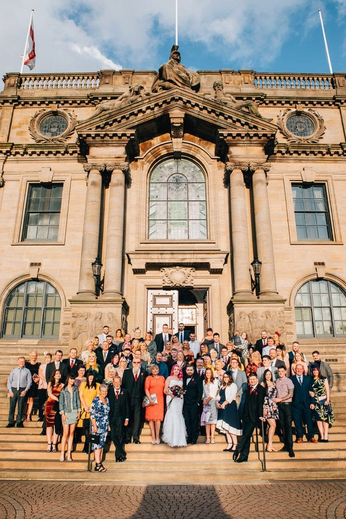 Group photo of the whole wedding in front of South Shields Town Hall