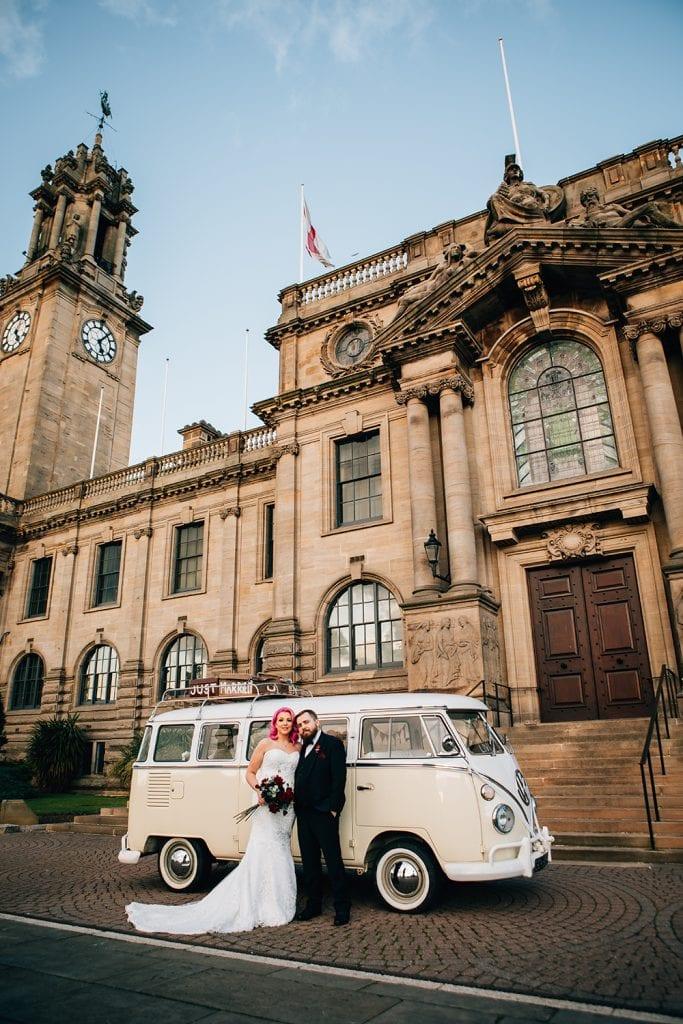 Bride and groom with their VW Camper Van