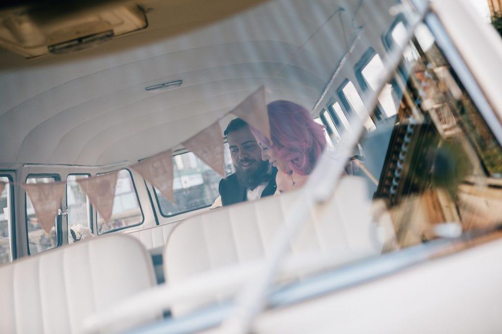 Bride & Groom viewed through the windscreen of their VW Camper Van