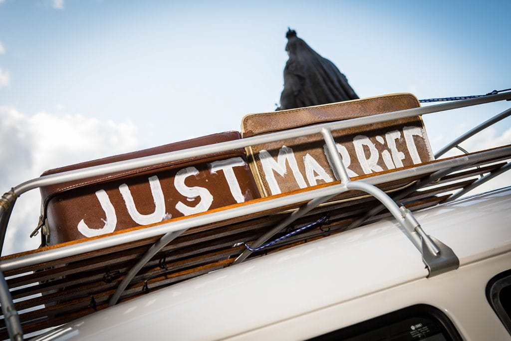 """JUST MARRIED"" suit cases on top of the VW Camper Van"