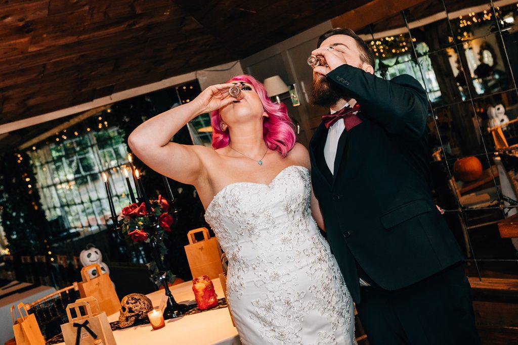 Bride & Groom knocking back shots at The Greyhound Inn