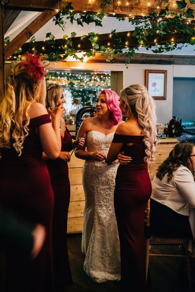 Bride Talking to her Bridesmaids at The Greyhound Inn