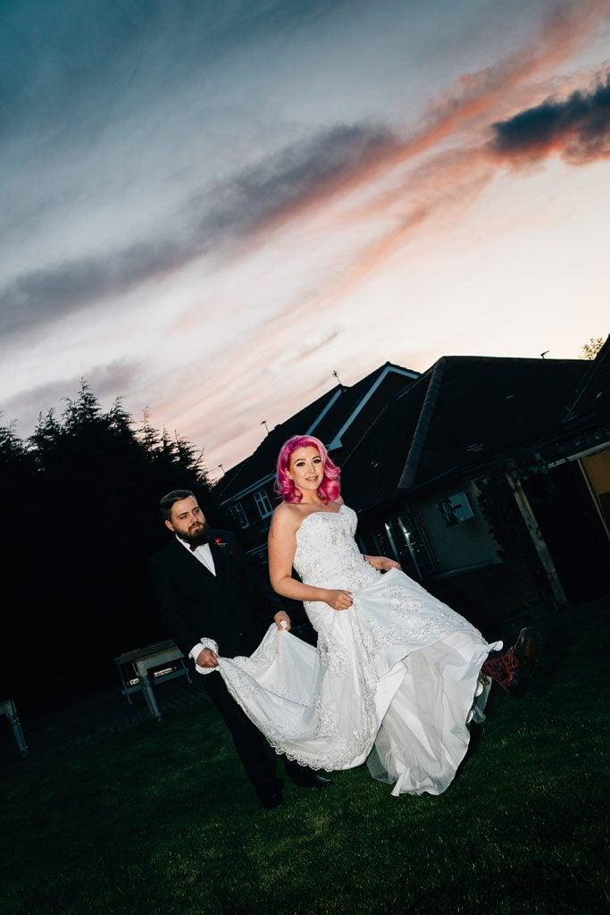 Bride & Groom waltzing through The Greyhound Inn Garden
