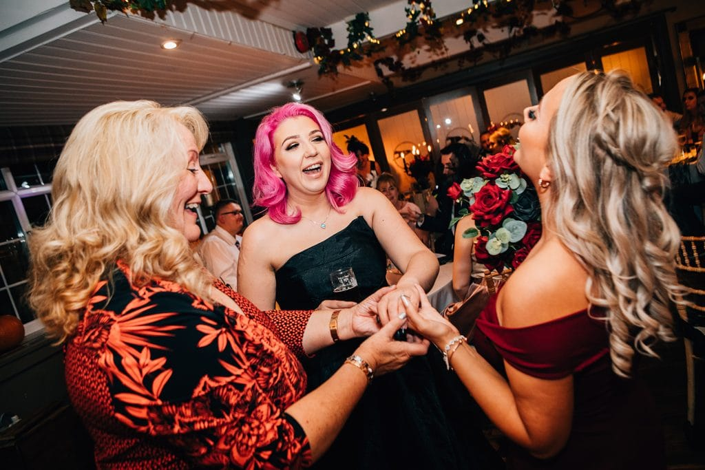Bride showing off her wedding ring at Bride & Groom walking through The Greyhound Inn