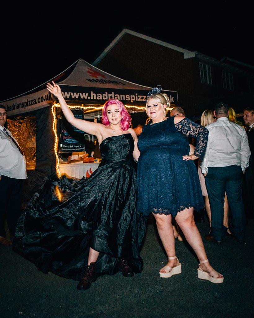 Bride showing off her Black Wedding Dress at The Greyhound Inn
