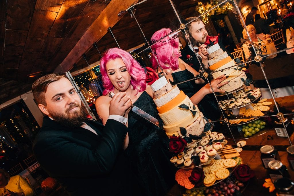 Bride & Groom cutting their wedding cheese at The Greyhound Inn