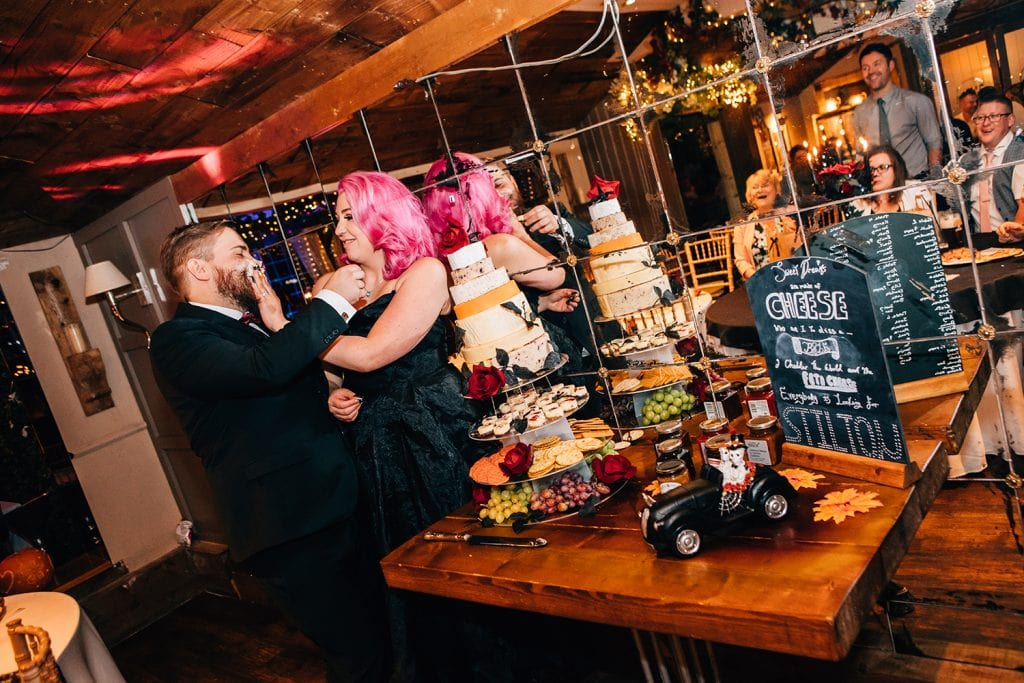 Bride smashing a cup cake into the grooms face at The Greyhound Inn