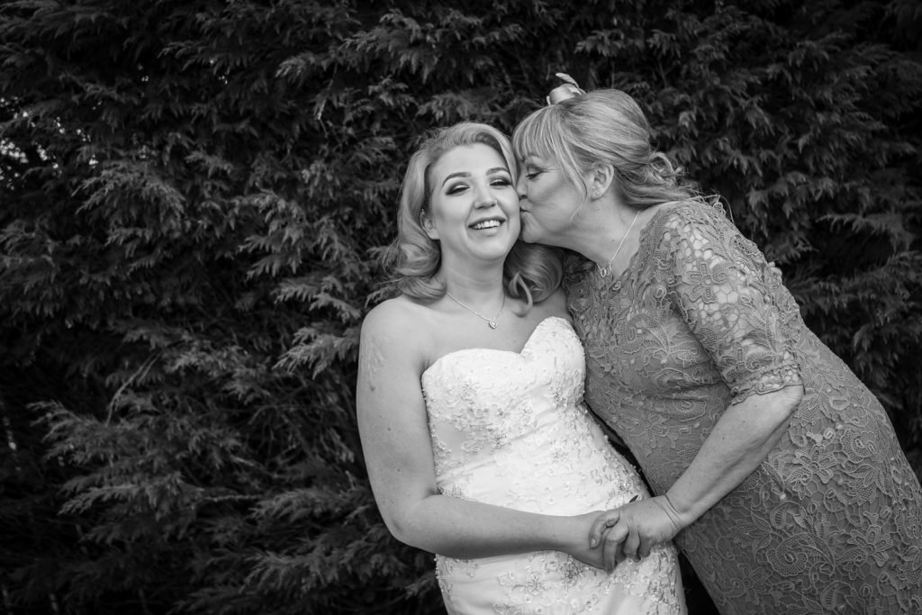 Bride getting a kiss from her mum at Family Photo at the Greyhound in Jarrow