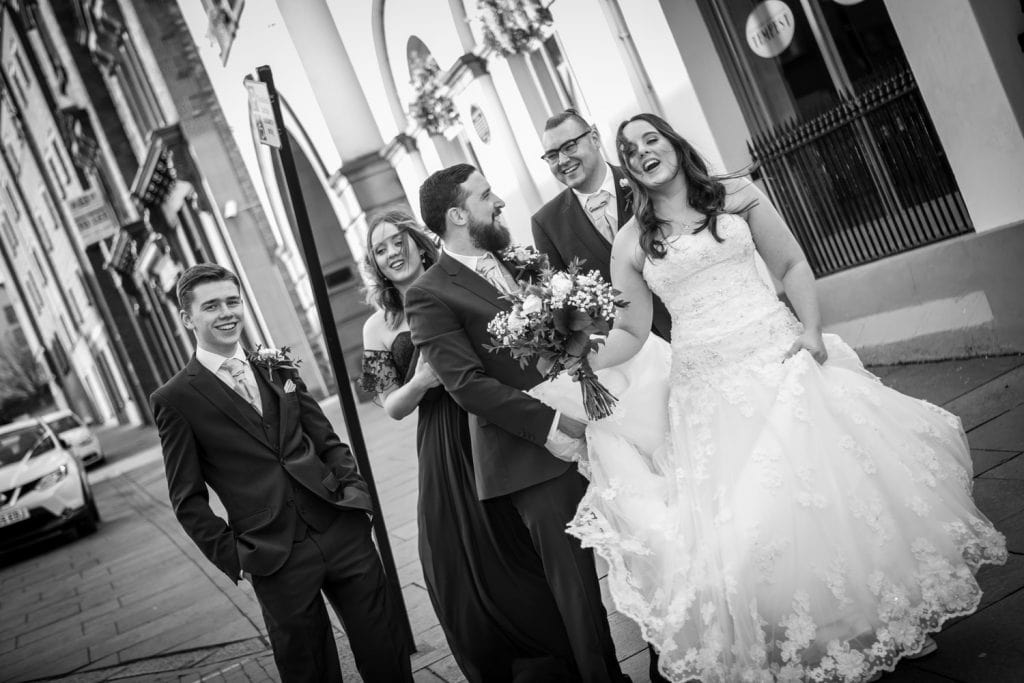 Bridal party walking to the river outside of Quayside Exchange Sunderland Wedding Photography