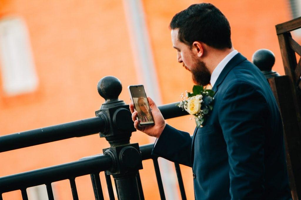 Groom video messaging his mum