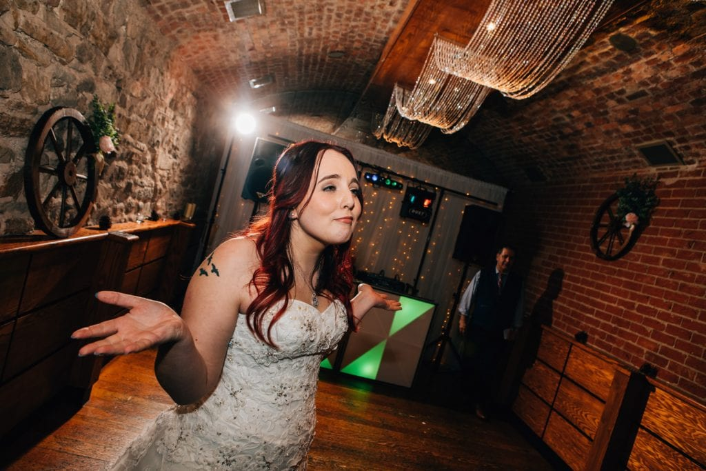 Bride looking for her groom at Quayside Exchange Sunderland Wedding Photography