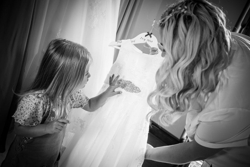 FLower girl looking at her dress