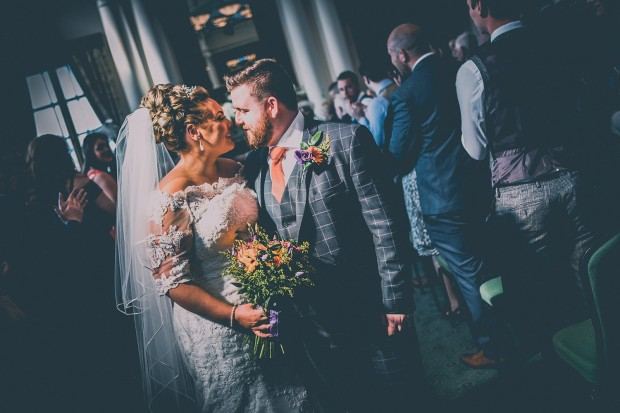 The bride & groom walking down the aisle at South Shields Town Hall