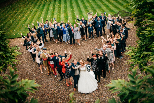 Bride & Groom with all of their guests in a heart shape group at Eshott Hall, Northumberland
